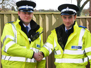 Danny Smith handing over to PCSO John Midgley